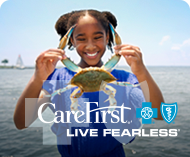 Girl holding crab; CareFirst Live Fearless